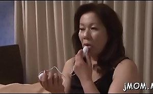 Sensual asian older bends over and takes a hard pounding