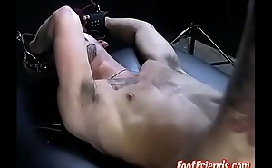 Tickling master showing his tricks to restrained submissive