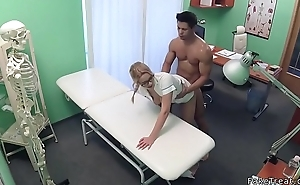Muscular dude pounds blonde nurse